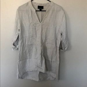 Grey v-neck button-up sleeved top